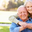 Outdoor Portrait Of Loving Senior Couple Smiling To Camera
